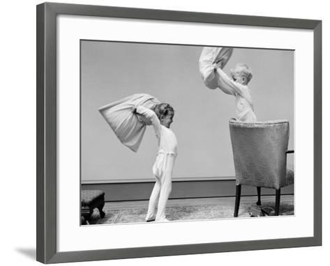 Boy and Girl Having a Pillow Fight, Boy Standing on Chair Swinging Pillow-H^ Armstrong Roberts-Framed Art Print