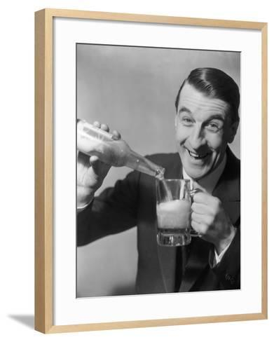 Man Pouring Himself a Glass of Beer-George Marks-Framed Art Print