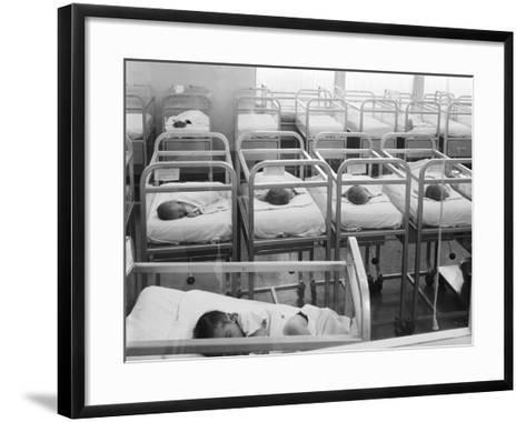 Newborn Baby Cribs in Hospital Nursery-H^ Armstrong Roberts-Framed Art Print