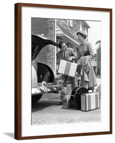 Smiling Couple Load Suitcases Into Trunk of Sedan-H^ Armstrong Roberts-Framed Art Print