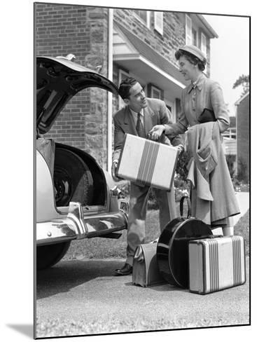 Smiling Couple Load Suitcases Into Trunk of Sedan-H^ Armstrong Roberts-Mounted Photographic Print