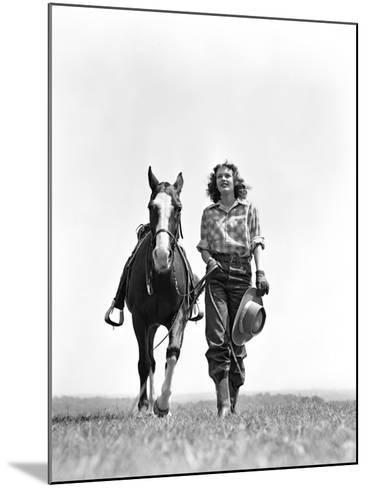 Woman Walking Beside Horse Holding Cowboy Hat in Gloved Hand-H^ Armstrong Roberts-Mounted Photographic Print