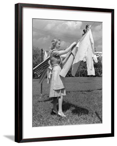 Woman, Housewife, is Outdoors, Hanging Clean Fresh Laundry on Clothesline-H^ Armstrong Roberts-Framed Art Print