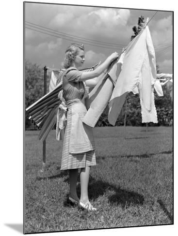 Woman, Housewife, is Outdoors, Hanging Clean Fresh Laundry on Clothesline-H^ Armstrong Roberts-Mounted Photographic Print
