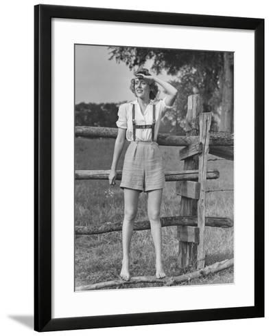 Barefoot Woman in Shorts Standing on Wooden Fence on Meadow-George Marks-Framed Art Print