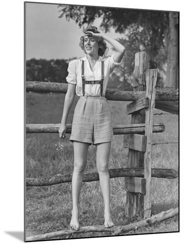 Barefoot Woman in Shorts Standing on Wooden Fence on Meadow-George Marks-Mounted Photographic Print