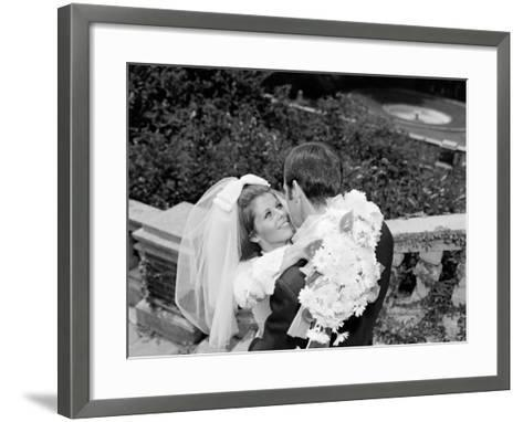 Smiling Bride Holding Bouquet of Daisies Embracing Groom-H^ Armstrong Roberts-Framed Art Print