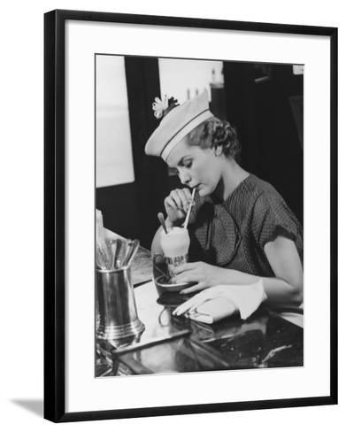 Young Woman in Fancy Hat Drinking Ice Cream Soda-George Marks-Framed Art Print