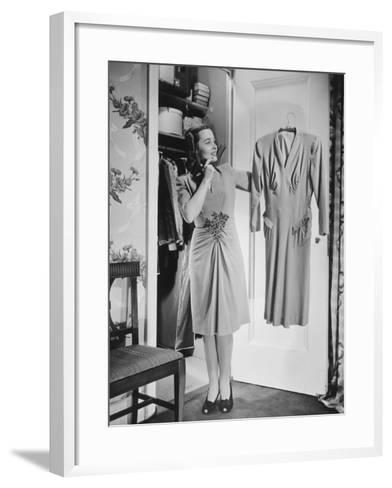 Woman Holding Dress at Opened Doors of Dressing-Room-George Marks-Framed Art Print