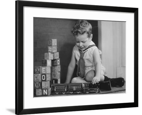 Boy (4-5) Playing With Model Train Set on Floor,-George Marks-Framed Art Print