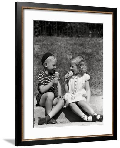 Boy and Girl Sitting on Curb, Eating Ice Cream Cones-H^ Armstrong Roberts-Framed Art Print