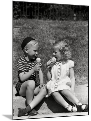 Boy and Girl Sitting on Curb, Eating Ice Cream Cones-H^ Armstrong Roberts-Mounted Photographic Print