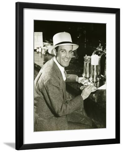 Man Sitting at Counter Eating Ice Cream-George Marks-Framed Art Print