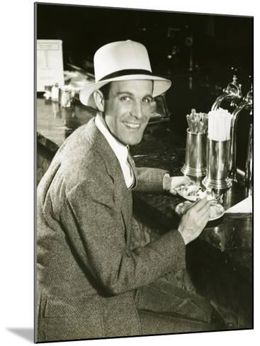 Man Sitting at Counter Eating Ice Cream-George Marks-Mounted Photographic Print