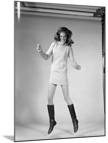 Woman Dancer in Mini-Dress and Black Go-Go Boots Jumping in Air-H^ Armstrong Roberts-Mounted Photographic Print