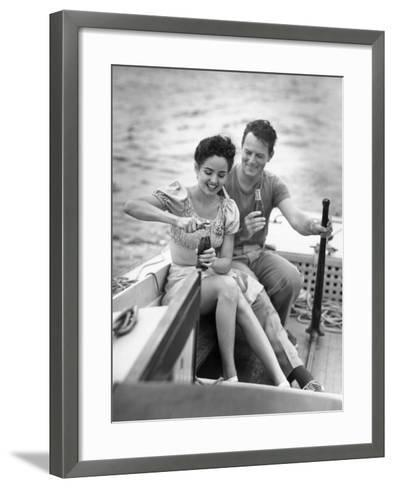 Couple on Small Sail-Boat Drinking Coke-George Marks-Framed Art Print