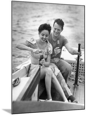 Couple on Small Sail-Boat Drinking Coke-George Marks-Mounted Photographic Print