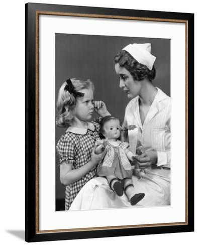 Nurse Consoling Young Girl and Her Doll-George Marks-Framed Art Print