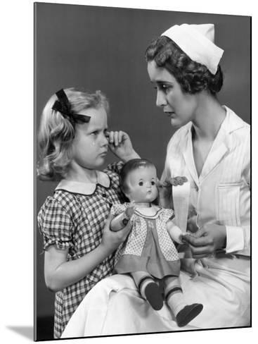 Nurse Consoling Young Girl and Her Doll-George Marks-Mounted Photographic Print