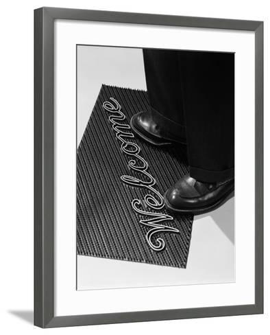 Man Stepping Onto Welcome Mat-H^ Armstrong Roberts-Framed Art Print
