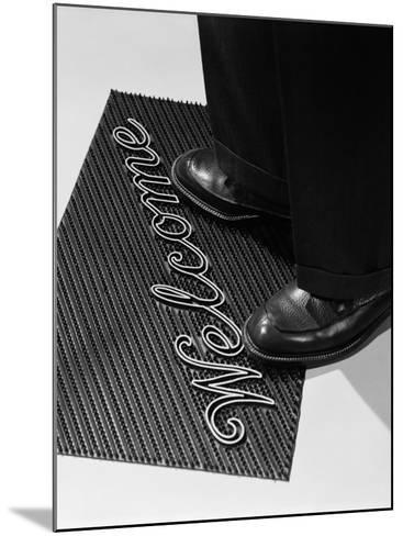 Man Stepping Onto Welcome Mat-H^ Armstrong Roberts-Mounted Photographic Print