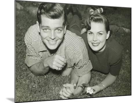 Young Couple Lying in Field, Portrait-George Marks-Mounted Photographic Print