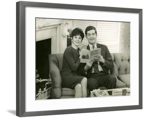 Couple Reading Together on Couch-George Marks-Framed Art Print