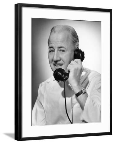 Doctor on the Telephone-George Marks-Framed Art Print