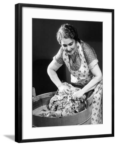 Smiling Housewife Doing Laundry-George Marks-Framed Art Print