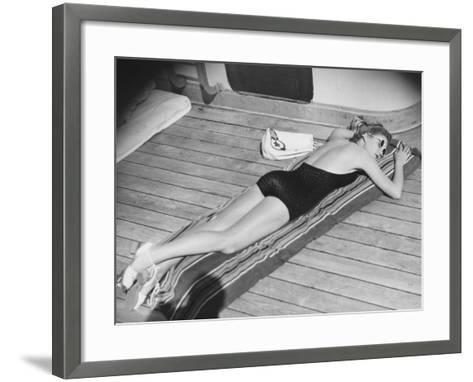 Young Woman Sun Tanning on Cruiser Deck-George Marks-Framed Art Print