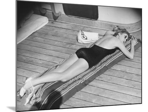Young Woman Sun Tanning on Cruiser Deck-George Marks-Mounted Photographic Print