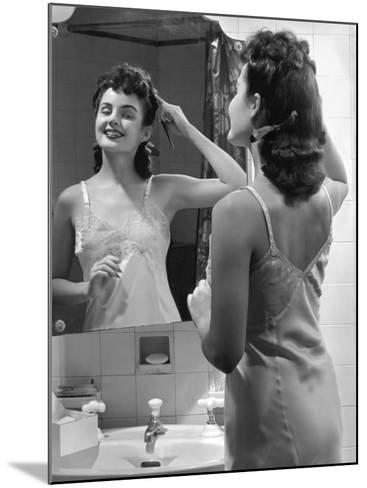 Woman Fixing Hair in Mirror-George Marks-Mounted Photographic Print