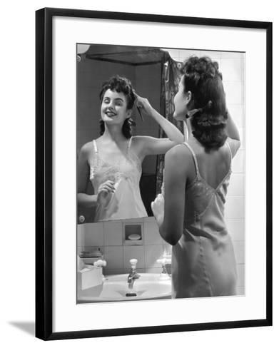 Woman Fixing Hair in Mirror-George Marks-Framed Art Print