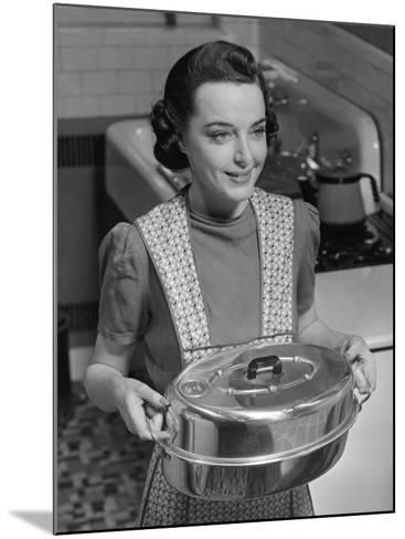 Housewife Hoding Roasting Pan-George Marks-Mounted Photographic Print