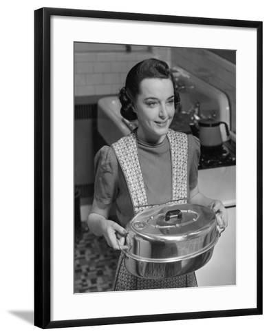 Housewife Hoding Roasting Pan-George Marks-Framed Art Print