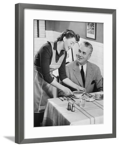 Woman Serving Soup To Husband-George Marks-Framed Art Print