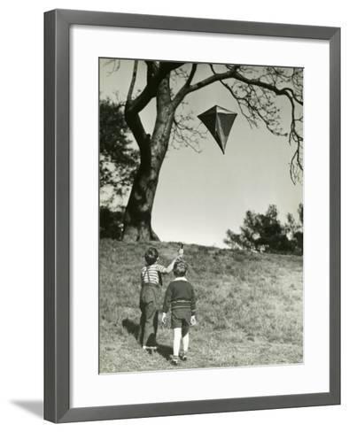 Small Boys Flying Kite-George Marks-Framed Art Print
