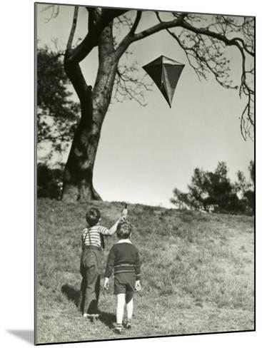 Small Boys Flying Kite-George Marks-Mounted Photographic Print