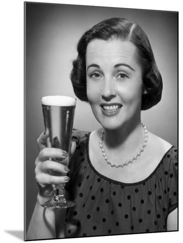 Woman Raising a Glass of Beer-George Marks-Mounted Photographic Print