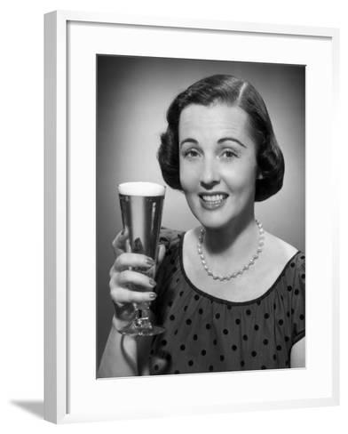 Woman Raising a Glass of Beer-George Marks-Framed Art Print