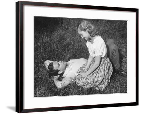 Young Couple Resting on Lawn-George Marks-Framed Art Print