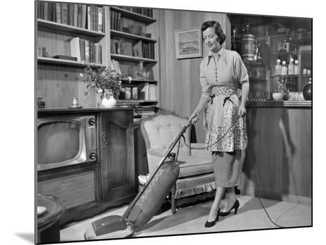 Apron Housewife Vacuuming Den-George Marks-Mounted Photographic Print