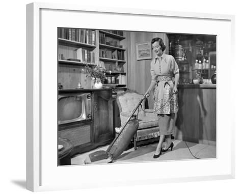 Apron Housewife Vacuuming Den-George Marks-Framed Art Print