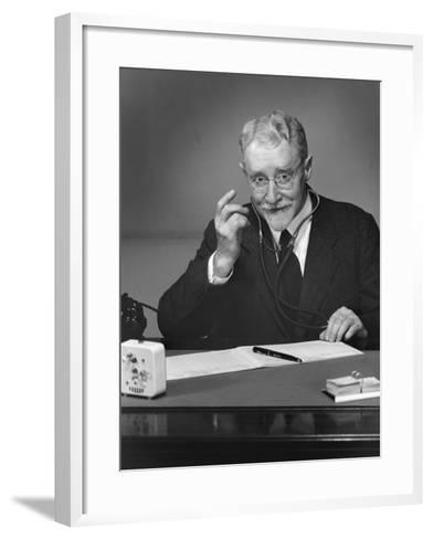 Doctor Sitting in Office-George Marks-Framed Art Print