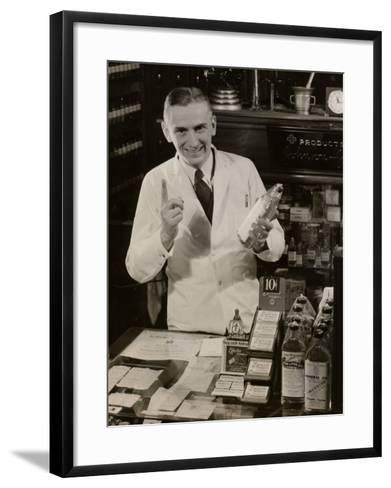 Pharmacist With Medicine-George Marks-Framed Art Print