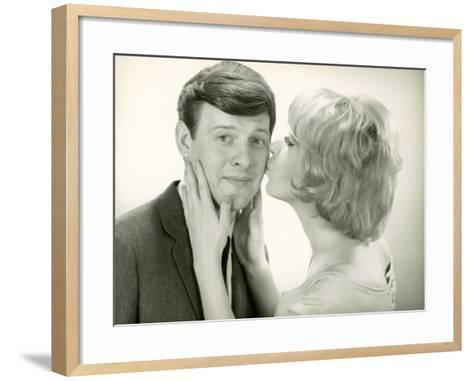 Woman Kissing Man on Cheek-George Marks-Framed Art Print