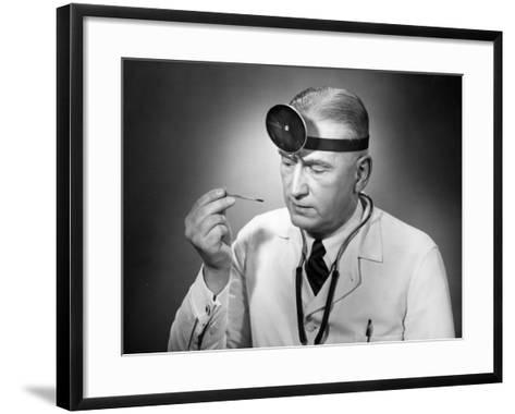 Doctor Reading Thermometer-George Marks-Framed Art Print