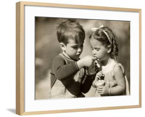 Boy Gives Ice Cream To Sister-George Marks-Framed Art Print