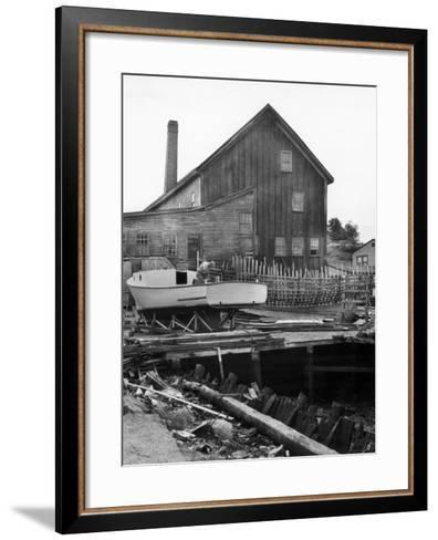 Man Building Boat-George Marks-Framed Art Print