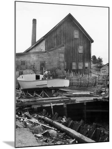 Man Building Boat-George Marks-Mounted Photographic Print